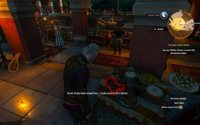 Use your Witcher Senses to search the refreshment tables.
